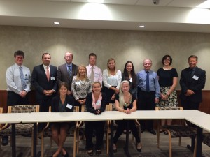 Interns and advisors meeting with doctors at the Mayo Clinic.