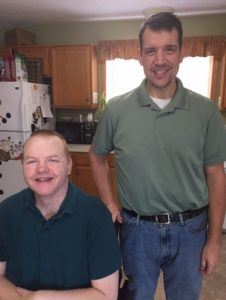 Full-Time direct care staff, Tim, with one of his residents.