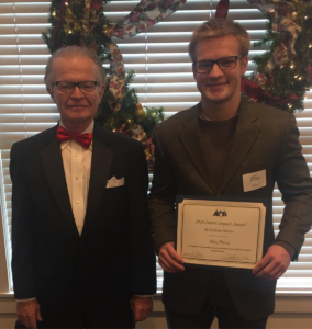 Alex receiving the internship impact award from Jim Nelson.